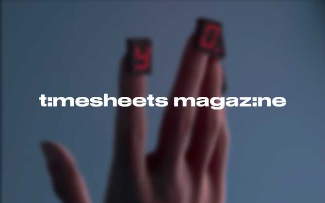'Timesheets Magazine' logo with a photo of a hand in the background